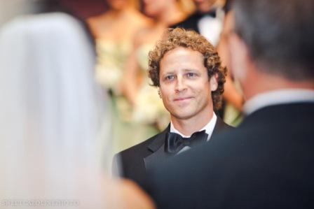groom seeing bride for first time down aisle